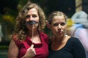 A moustache on a stick really makes a red dress pop.