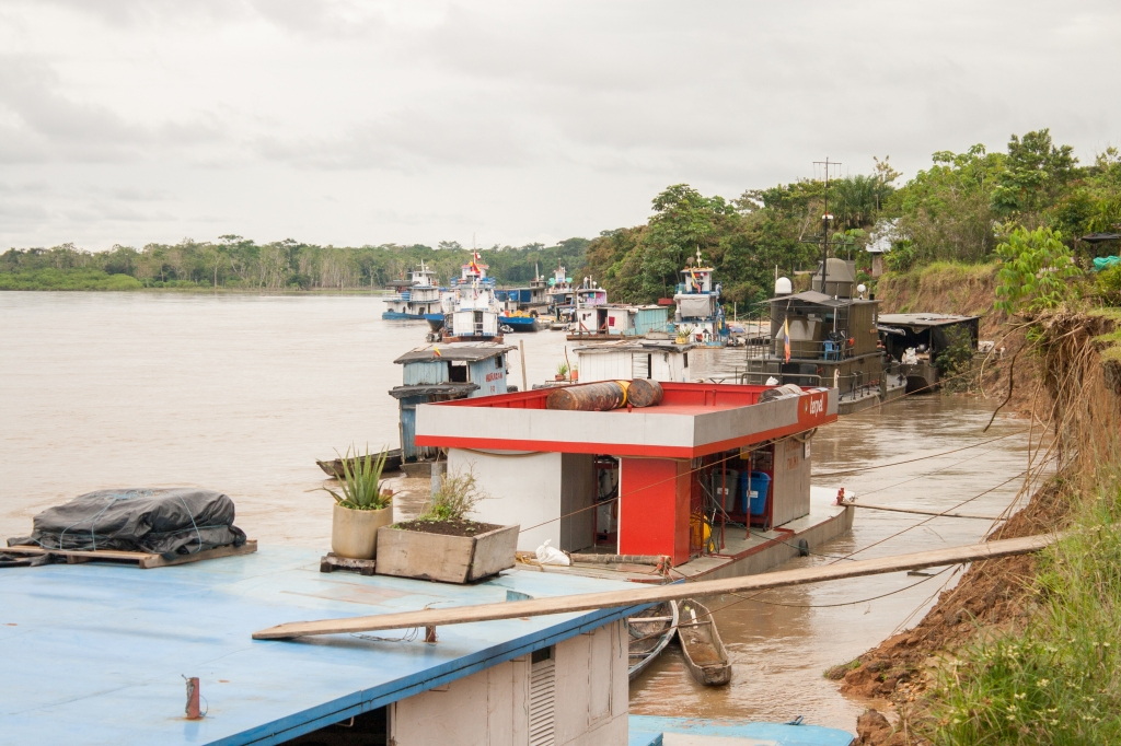 Barges and warships docked at the port on the Putumayo River